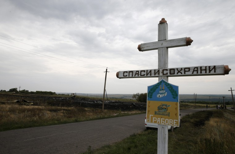 The village sign of Grabovo is seen near debris at the site of Thursday's Malaysia Airlines Boeing 777 plane crash, near Grabovo in the Donetsk region July 18, 2014. World leaders demanded an international investigation into the shooting down of Malaysia Airlines Flight MH17 with 298 people on board over eastern Ukraine, as Kiev and Moscow blamed each other for a tragedy that stoked tensions between Russia and the West. (Maxim Zmeyev/Reuters)