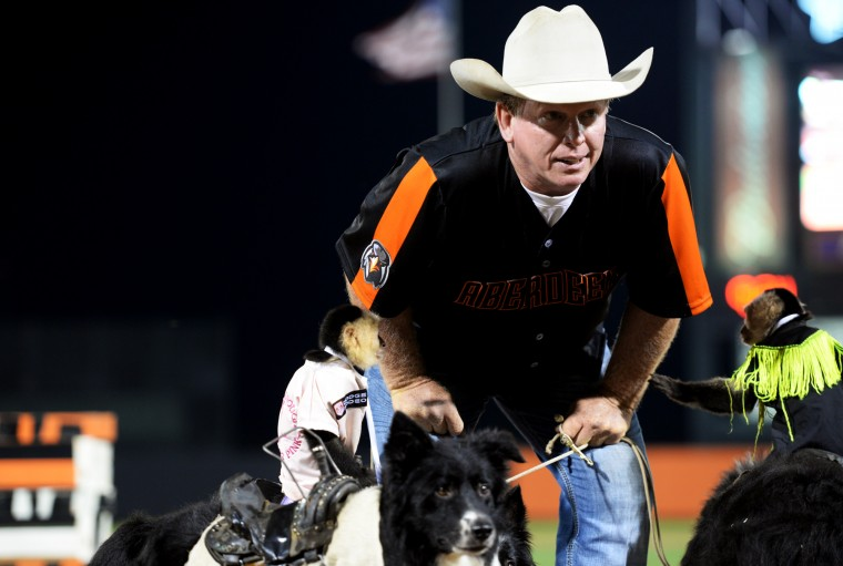 Tim Lepard performs with his monkey-and-dog duos at Ripken Stadium in Aberdeen after an IronBirds game, Thursday, July 10, 2014. (Jon Sham/BSMG)