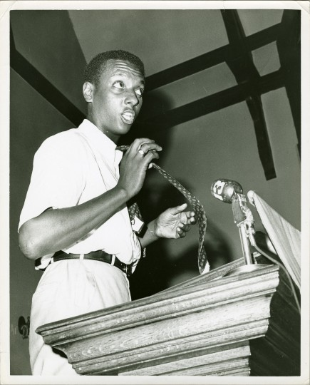 Stokely Carmichael loosens his tie while speaking at a Baltimore CORE Convention. Carmichael made appearances at Metropolitan Methodist Church and Morgan State. (Richard Childress, Maryland Historical Society)