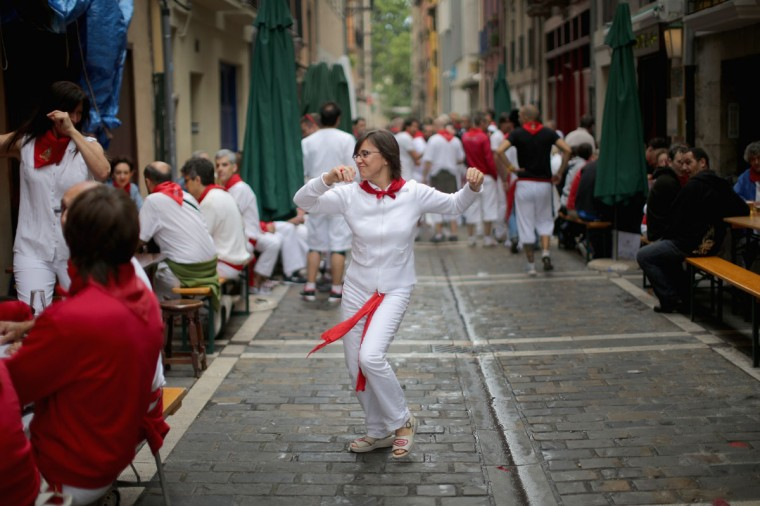 Locals dance in the street during the second day of the San Fermin Running Of The Bulls festival, on July 7, 2014 in Pamplona, Spain. (Photo by Christopher Furlong/Getty Images)