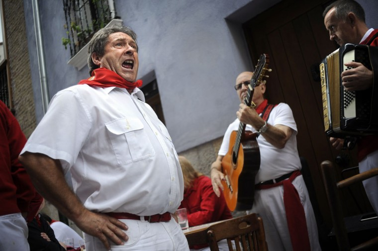 A band performs a jota (traditional song from the province of Navarre) during the San Fermin Festival, on July 7, 2014, in Pamplona, northern Spain. (RAFA RIVAS/AFP/Getty Images)