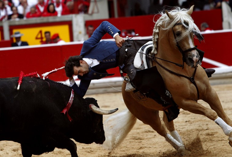 Spanish rejoneador (bullfighter on horseback) Sergio Galan performs at the Plaza de Toros on the first day of the San Fermin festival in Pamplona on July 6, 2014. (REUTERS/Joseba Etxaburu)