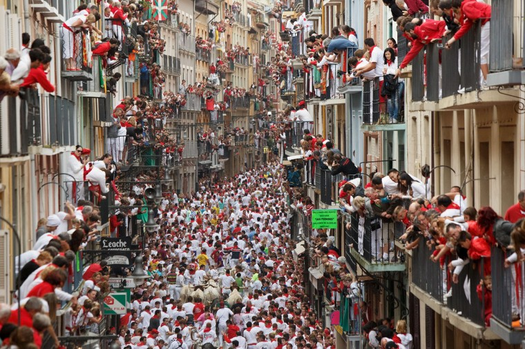 Revellers run with Torrestrella's fighting bulls along the Calle Estafeta during the second day of the San Fermin Running Of The Bulls festival on July 7, 2014 in Pamplona, Spain. (Photo by Pablo Blazquez Dominguez/Getty Images)