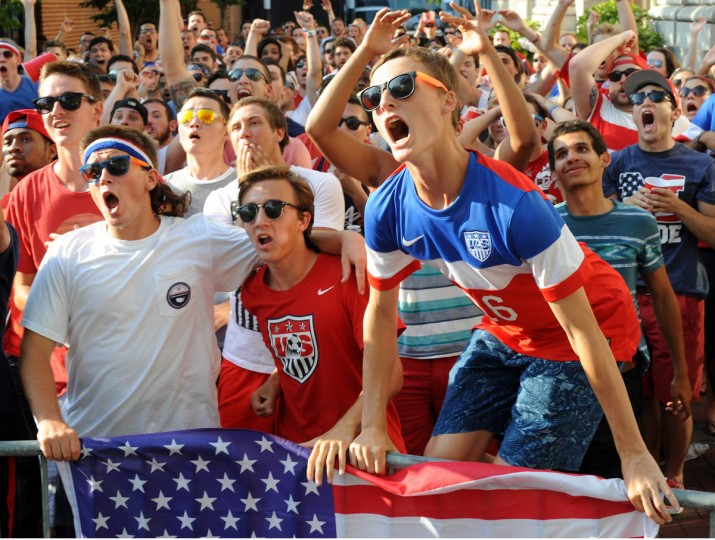 Gavin Bailey, 19, right, from Hereford, gets jumpy about a play during overtime. Next to him are his friends Jaxon Frasier, 18 (white T-shirt), left, and Adam Caulk, 18, center. Fans gather at the Power Plant Live! to watch the United States' World Cup Round of 16 match against Belgium which went into overtime with a Belgian win. The US lost. (Algerina Perna/Baltimore Sun)