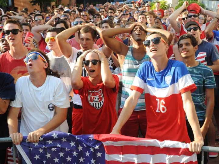 Fans gather at the Power Plant Live! to watch the United States' World Cup Round of 16 match against Belgium. Front row from Hereford are, from left: Jaxon Frasier, 18, Adam Caulk, 18, and Gavin Bailey, 18 react to Belgium scoring a goal in extra time. The US lost in extra time. (Algerina Perna/Baltimore Sun)