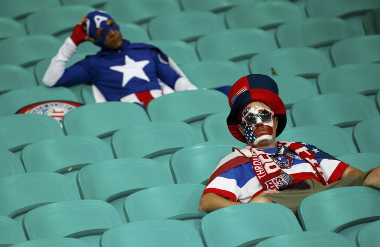 U.S. fans show dejection at the end of the extra time of the 2014 World Cup round of 16 game between U.S. and Belgium at the Fonte Nova arena in Salvador July 1, 2014. (Sergio Moraes/Reuters photo)