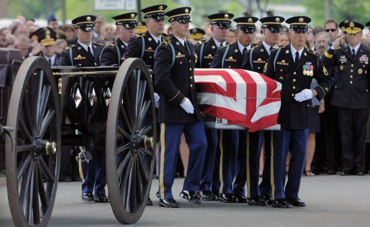 Members of The Old Guard, U.S. Army 3rd Infantry Regiment, carry the casket of Major General Harold J. Greene of the U.S. Army, towards his grave site in Section 60 at Arlington National Cemetery in Arlington, Va. on Thursday, August 14, 2014. (Al Drago/Baltimore Sun)