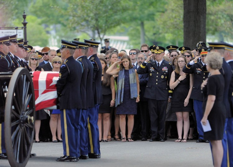Dr. Susan Myers, center, salutes as her husband, Major General Harold J. Greene, U.S. Army, is carried off towards his gravesite in Section 60 at Arlington National Cemetery in Arlington, Va. on Thursday, August 14, 2014. (Al Drago/Baltimore Sun)