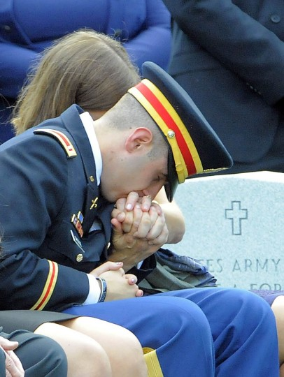 1st Lt. Matthew Greene kisses the hand of his mother, Dr. Susan Myers, during funeral services for US Army Major General Harold Greene at Arlington National Cemetery in Arlington, Virginia, on August 14, 2014. (Al Drago/Al Drago)