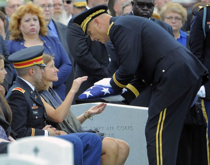 Dr. Susan Myers receives the flag that covered the casket of her husband, Major General Harold J. Greene of the U.S. Army, from U.S. Army Chief of Staff Gen. Ray Odierno, as she sits alongside her son, 1st Lt. Matthew Greene, during Greene's burial at Arlington National Cemetery in Arlington, Va. on Thursday, August 14, 2014. (Al Drago/Baltimore Sun)