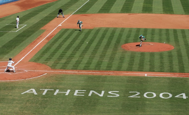 Chris Oxspring #35 of Australia pitches to Atsushi Fujimoto #25 of Japan in the baseball semifinal game on August 24, 2004 during the Athens 2004 Summer Olympic Games at the Baseball Centre in the Helliniko Olympic Complex in Athens, Greece. (Robert Laberge/Getty Images)