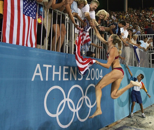 Kerri Walsh of United States celebrates defeating Adriana Behar and Bede Shelda of Australia in the women's gold medal Beach Volleyball match on August 24, 2004 during the Athens 2004 Summer Olympic Games at the Olympic Beach Volleyball Centre at the Faliro Coastal Zone Complex in Athens, Greece. USA won 21-17, 21-11. (Jonathan Ferrey/Getty Imag