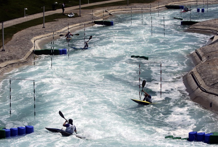 Athletes train during the first day of the ICF World Cup Canoe/Kayak Slalom Racing at the Hellinikon Olympic Complex in Athens, 08 July 2005. (Aris Messinis/Getty Images)