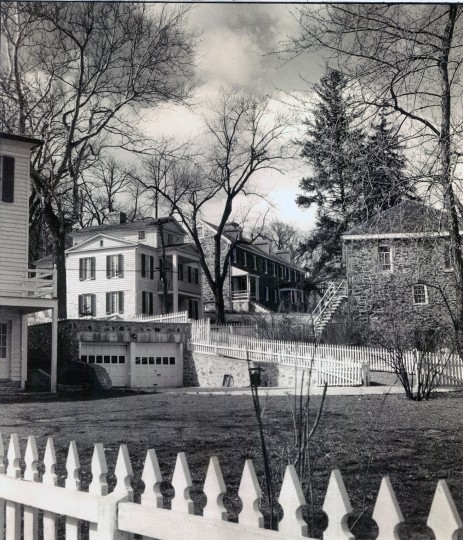 March 23, 1937: A view up the slope of Dickeyville's tree-lined main street, Pickwick Road, with several remodeled houses in view. Garages may be a more modern touch, but picket fences painted brightly are keeping with the village atmosphere. Dickeyville has been on the National Register of Historic Places since 1972, which means that residents must follow guidelines when working on the exterior of their homes. (Sun file)