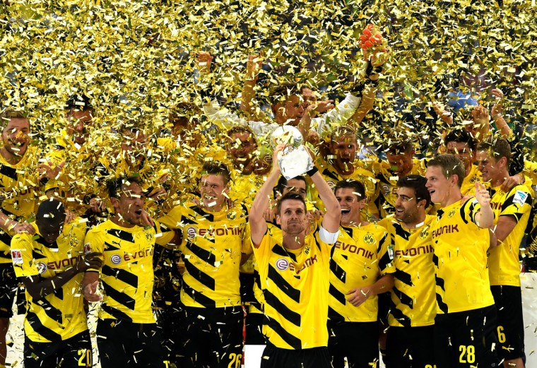 Dortmund captain Sebastian Kehl lifts the trophy following his team's 2-0 victory during the DFL Supercup between Borrussia Dortmund and FC Bayern Muenchen at Signal Iduna Park in Dortmund, Germany. (Lars Baron/Bongarts/Getty Images)