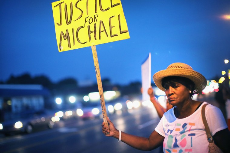 Gwen Stewart joins other demonstrators along West Florissant Avenue to protest the shooting death of Michael Brown on August 14, 2014 in Ferguson, Missouri. Violent protests have erupted along West Florissant in Ferguson each of the last four nights as demonstrators express outrage over the shooting death of Michael Brown by a Ferguson police officer on August 9. (Photo by Scott Olson/Getty Images)