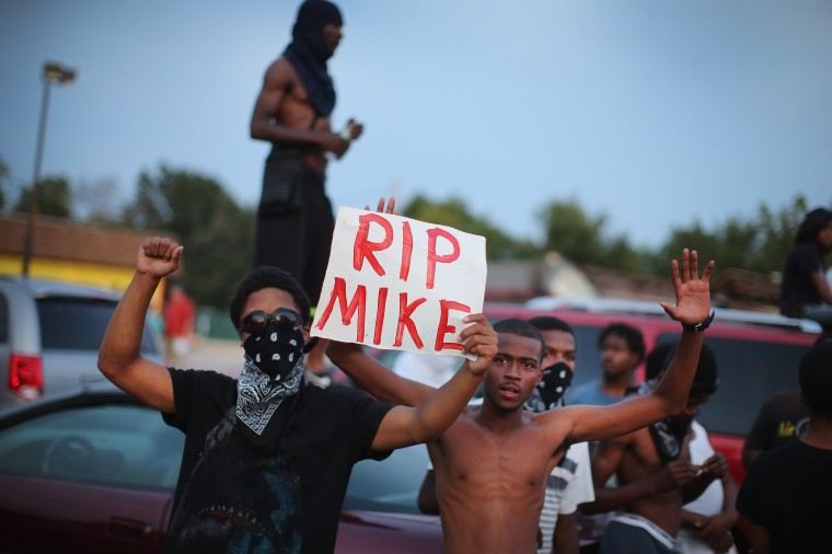 Demonstrators gather along West Florissant Avenue to protest the shooting death of Michael Brown on August 14, 2014 in Ferguson, Missouri. Violent protests have erupted along West Florissant in Ferguson each of the last four nights as demonstrators express outrage over the shooting death of Michael Brown by a Ferguson police officer on August 9. (Photo by Scott Olson/Getty Images)