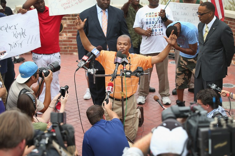 Eric Davis, a cousin to Michael Brown, talks about the night brown was shot during a press conference outside the police department on August 15, 2014 in Ferguson, Missouri. Brown was shot and killed by a Ferguson police officer on August 9. The killing sparked several days of violent protests in the city. (Photo by Scott Olson/Getty Images)