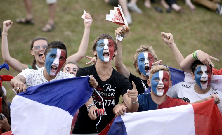 French fans cheer for their team before the 2014 Women's Rugby Union World Cup pool C match between France and South Africa in Marcoussis in the southern suburbs of Paris. (Stephane De Sakutin/Getty Images)