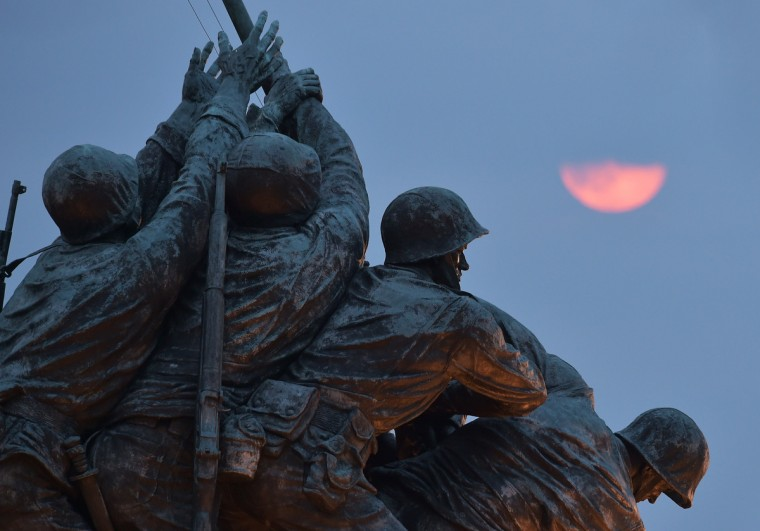 "The perigee moon or ""supermoon"" rises above the US Marine Corp War Memorial on August 10, 2014 in Arlington, VA. Tonght's supermoon is the largest and closest full moon of the year. It is 14 percent closer and 30 percent brighter than other full moons of the year, according to NASA. (Mandel Ngan/Getty Images)"