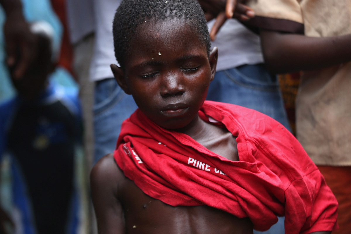 Clinging to life, a 10-year-old Ebola victim