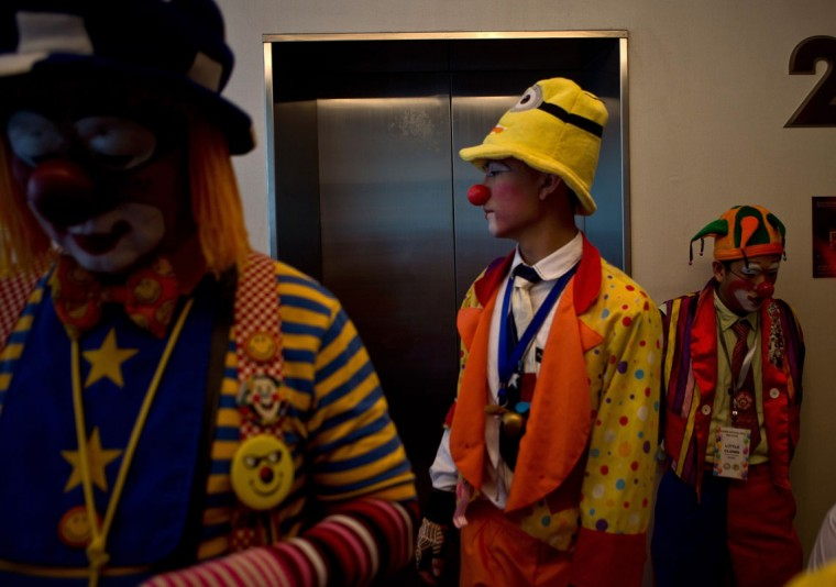 Clowns prepare to take part in a Clown Festival in Kuala Lumpur on August 17, 2014. Around 80 clowns from all over Malaysia took part in the event organized by the Association of Clowns Malaysia to provide a platform for clown education, acquiring new skills and offering members support. (Manan Vatsyayana/AFP/Getty Images)