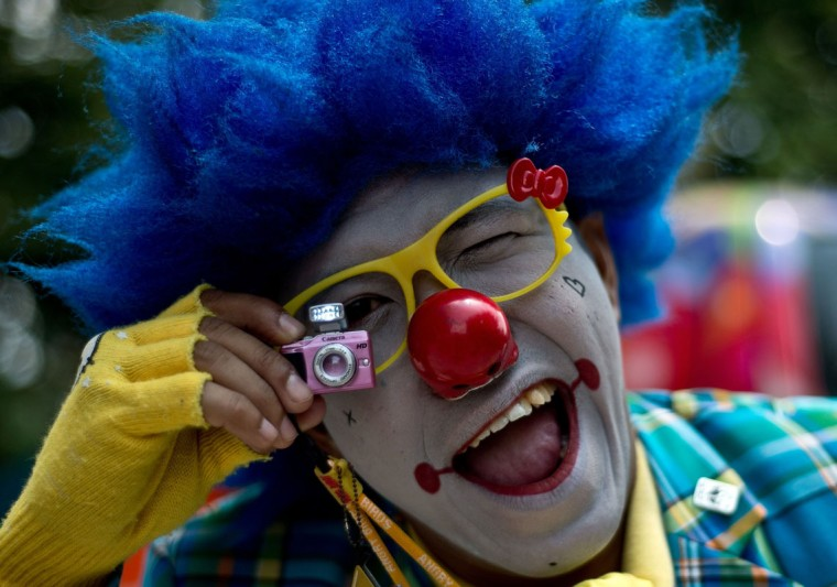 Malaysian clown Mohd Bukhari, aka Mr. JAJA, gestures during a Clown Festival in Kuala Lumpur on August 17, 2014. Around 80 clowns from all over Malaysia took part in the event organized by the Association of Clowns Malaysia to provide a platform for clown education, acquiring new skills and offering members support. Clowns pose for pictures during a Clown Festival in Kuala Lumpur on August 17, 2014. Around 80 clowns from all over Malaysia took part in the event organized by the Association of Clowns Malaysia to provide a platform for clown education, acquiring new skills and offering members support. (Manan Vatsyayana/AFP/Getty Images)
