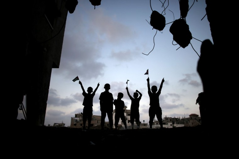 Palestinian boys play amid the rubble of destroyed house in Gaza City's Shejaiya neighborhood on August 17, 2014. (THOMAS COEX/AFP/Getty Images)