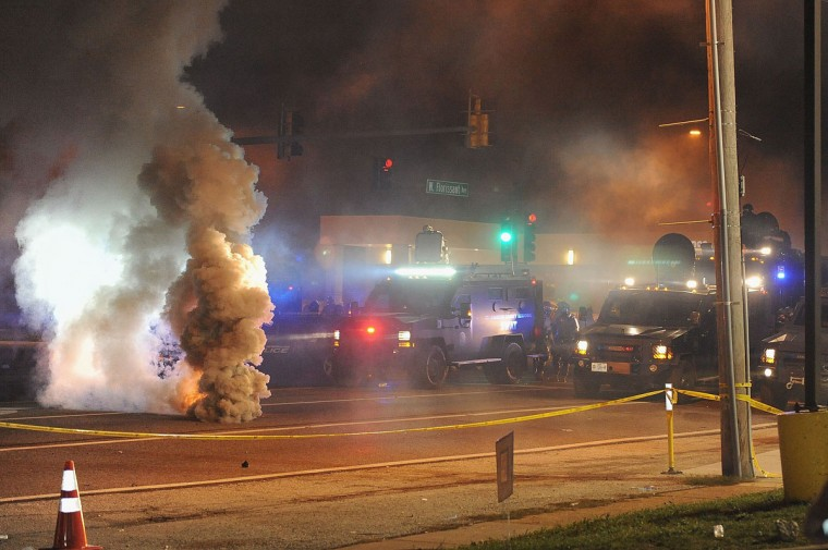 Law enforcement fires tear gas on protesters on West Florissant Road in Ferguson, Missouri on August 17, 2014. (Michael B. Thomas/AFP/Getty Images)