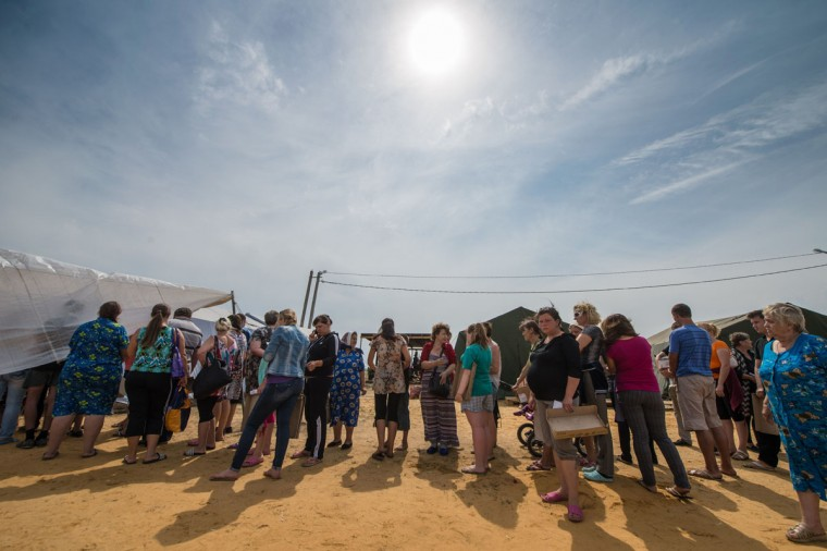 Refugees from eastern Ukraine queue to get food in a refugee camp near the Russian city of Donets'k, Rostov region, about 15 kilometers from the Russian-Ukrainian border. Some 285,000 people have already fled their homes due to the conflict in east Ukraine, it is estimated, with many leaving for other parts of the country, but close to 168,000 seeking sanctuary in Russia. (DMITRY SEREBRYAKOV/AFP/Getty Images)