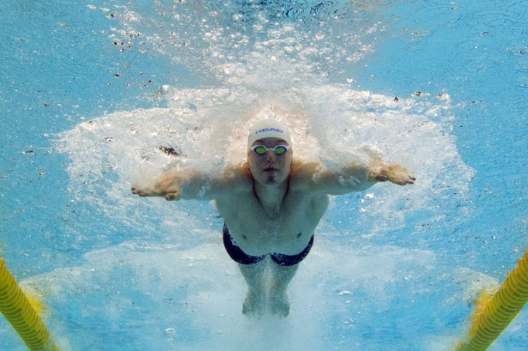 This picture taken with an underwater camera shows Ukraine's Andriy Govorov competing in the heats of the men's 50m Butterfly event of the 32nd LEN European Swimming Championships on August 18, 2014 in Berlin. (DAMIEN MEYER/AFP/Getty Images)