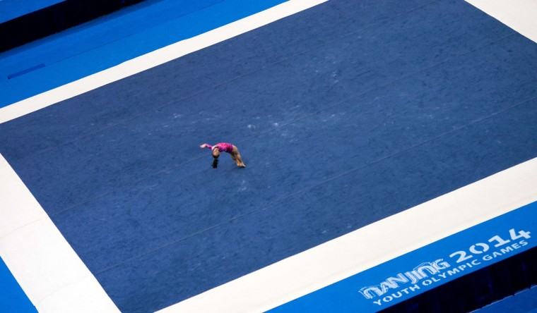 Wang Yan of China competes on the floor during the qualification round of the artistic gymnastics competition at the 2014 Youth Olympic Games in Nanjing, in eastern China's Jiangsu province on August 18, 2014. More than 3,700 competitors aged 15 to 18 were expected to participate in the games, with many hoping to build towards a place at the 2016 Summer Games in Rio de Janeiro. (JOHANNES EISELE/AFP/Getty Images)