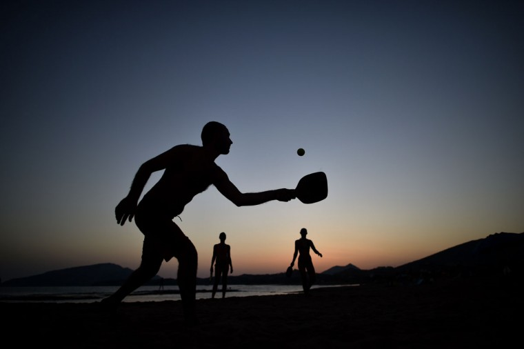 People play ping at the beach of Legrena, some 60 kilometers south of Athens in August 23, 2014. (Aris Messins/AFP/Getty Images)