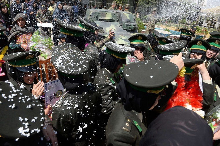 Newly-graduated female Afghan National Army (ANA) officers are showered with confetti foam after a graduation ceremony at the Afghan National Army training centre in Kabul on August 24, 2014. Afghan security forces are due to take over from their Western allies, a US-led NATO force, by the end of 2014 when the foreign troops leave the country. (Shah Marai/AFP/Getty Images)