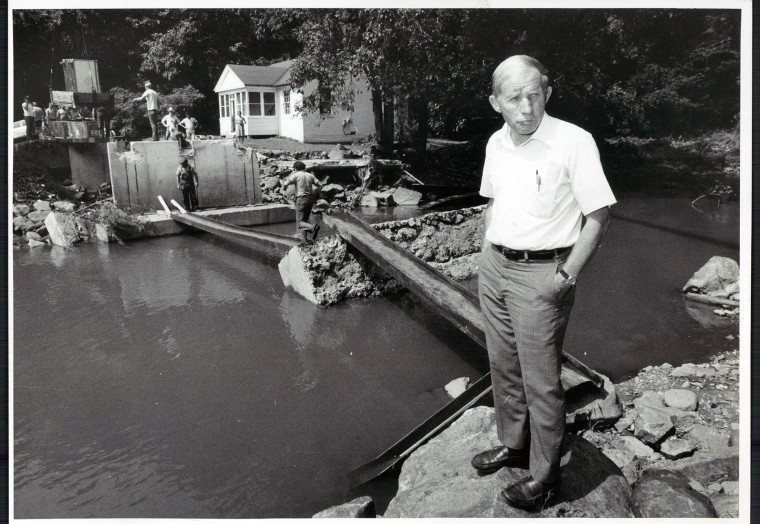 Sept. 8, 1979: Charles L. Wagandt surveys the damage at a washed out bridge in Dickeyville as workmen remove debris scattered by tropical storm David. (Weyman Swagger/Sun file)