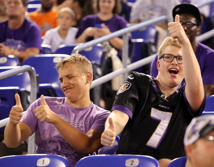 Raiff Bauer, 16, left, and Sebastian Bauer, 19, from Baltimore, dance to music during a timeout as the Baltimore Ravens take on the San Francisco 49ers at M&T Bank Stadium in Baltimore, MD on Thursday, August 7, 2014. (Al Drago/Baltimore Sun)