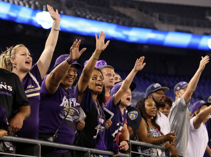 Fans cheer as Ravens players head into the locker room after their 23-3 victory over the San Francisco 49ers at M&T Bank Stadium in Baltimore, MD on Thursday, August 7, 2014. (Al Drago/Baltimore Sun)