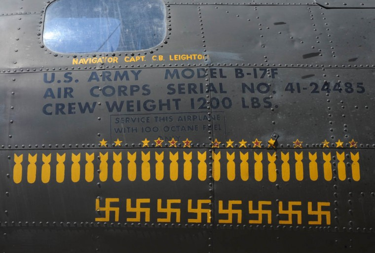 "The side of the aircraft, The Movie Memphis Belle,"" has the same designs used on the original plane which fought 25 missions in WWII. Each bomb drawing represents one mission. Each Swastika represents a German fighter that was shot down by a crew member. (Algerina Perna/Baltimore Sun)"