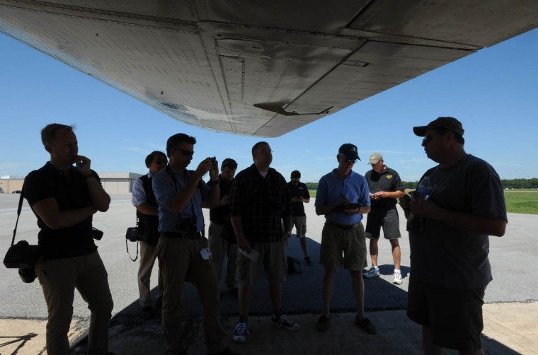 Bob Hill, the pilot from Nashville, TN, far right, briefs the press on the history of the plane before boarding. (Algerina Perna/Baltimore Sun)