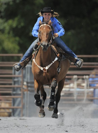 Courtney Casper of Linganore H.S. races on her horse during the pole bending competition. (Lloyd Fox/Baltimore Sun)