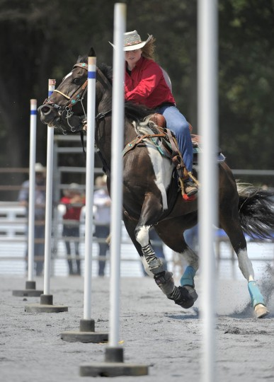 Olivia Hickman of Parkside High School weaves her way through the poles during the pole bending event. (Lloyd Fox/Baltimore Sun)