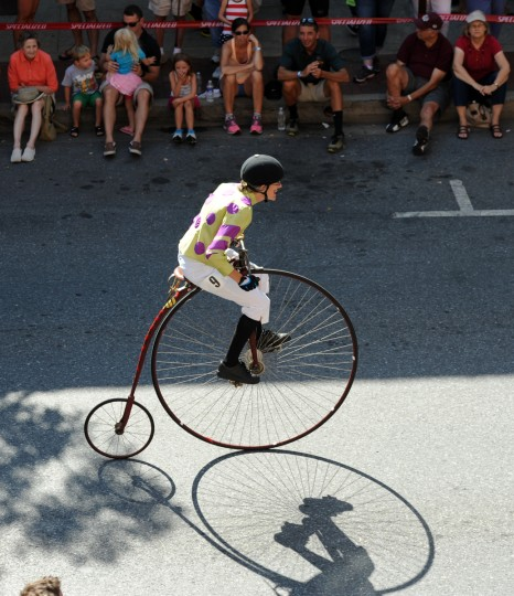 Alison Torpey of Louisville, Ky., who is dressed as a jockey, rides a 1886 Expert Columbia penny farthing on N. Market Street in the 2014 Frederick Clustered Spires High Wheel Race. (Kim Hairston/Baltimore Sun)