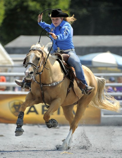 Georgeanna Lowe of Howard H.S. heads down the ring after circling the last barrel in the barrel racing competition. (Lloyd Fox/ Baltimore Sun)
