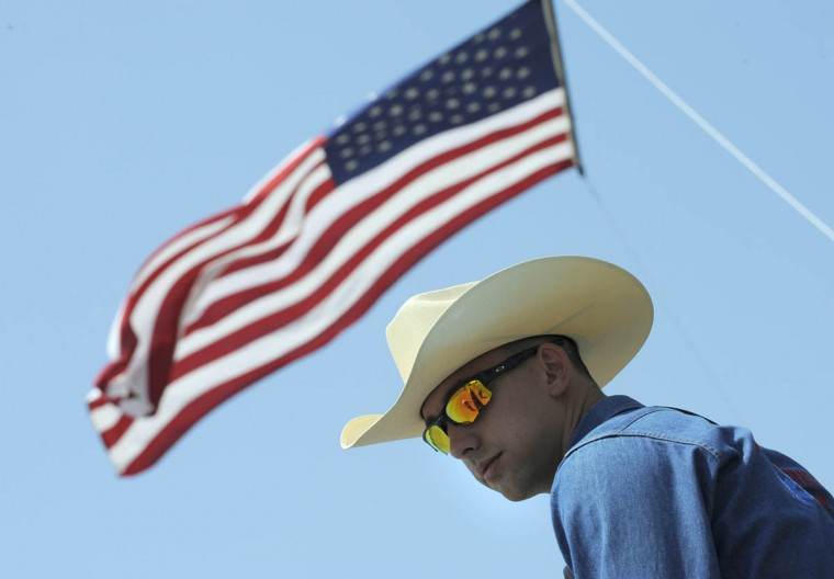 Jon Inskeep with the rodeo rescue team keeps an eye on the action in case of emergency. (Lloyd Fox/Baltimore Sun)