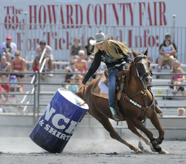 Lauren Keeney of Middletown H.S. in Frederick, tips over a barrel during the barrel racing competition at the rodeo. (Lloyd Fox/Baltimore Sun)