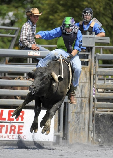 BJ Greene of Middletown H.S. takes his first ride of the day in the bull riding competition. (Lloyd Fox/Baltimore Sun)