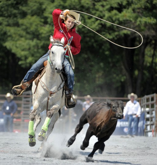 Morgan Meekins in the Middle School division of Meredith Middle School in Delaware tries to lasso a calf during the breakaway roping competition. (Lloyd Fox/Baltimore Sun)