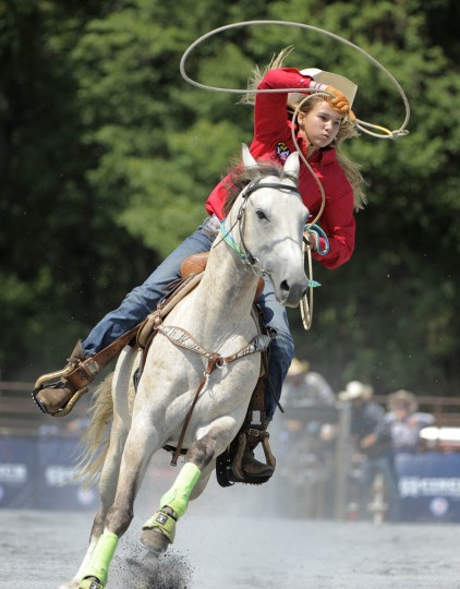 Morgan Meekins of Meredith Middle School in Delaware, tries to lasso a calf during the breakaway roping competition. (Lloyd Fox/Baltimore Sun)