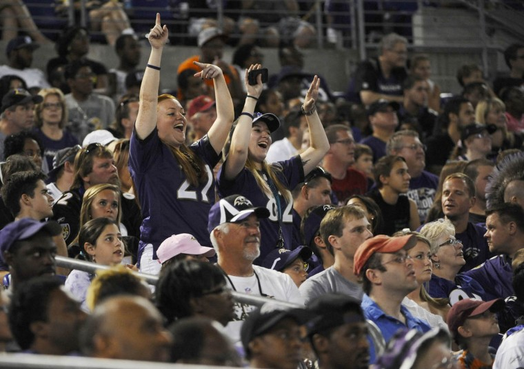 Fans jump up and dance during the game against the San Francisco 49ers at M&T Bank Stadium on August 7, 2014. (Rachel Woolf/Baltimore Sun)