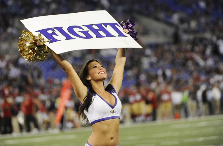 "A Ravens cheerleader holds up a ""Fight"" sign in the game against the San Francisco 49ers at M&T Bank Stadium on August 7, 2014. The Ravens won 23-3. (Rachel Woolf/Baltimore Sun)"